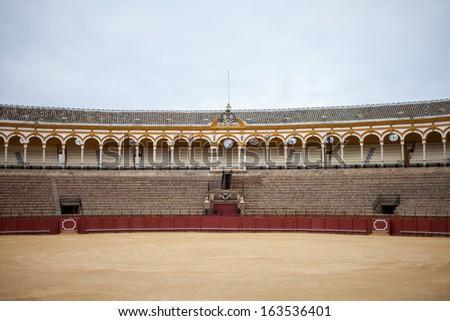 Big empty Bullfighting ring in Sevilla, Spain - stock photo