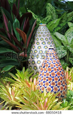 Big enameled vase pretty flower patterns stock photo royalty free big enameled vase with pretty flower patterns decorating the garden surrounded by bromeliad plant mightylinksfo