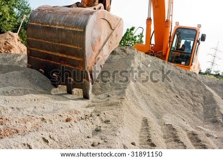BIG Excavator at a construction site - stock photo