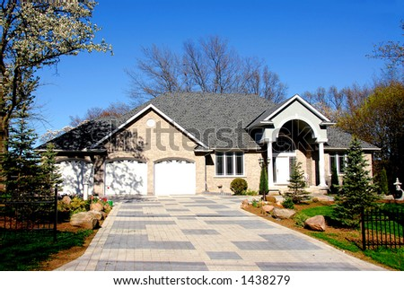 Big executive home in early spring - stock photo