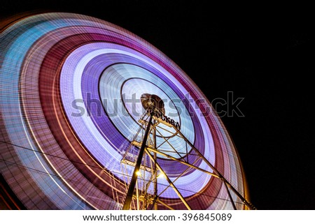 Big fairy panoramic wheel in Moscow park at evening time in motion - stock photo