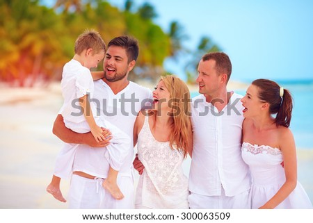 big family, group of friends having fun on tropical beach, summer vacation - stock photo