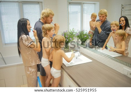 Big Family with Three children In Bathroom Brushing Teeth
