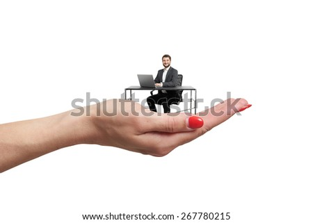 big female palm holding small man at table with computer. isolated on white background - stock photo