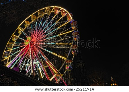 Big Ferris Wheel, East Princes Street Gardens, Edinburgh, Scotland, part of the Christmas and Hogmanay holiday attractions, at night.