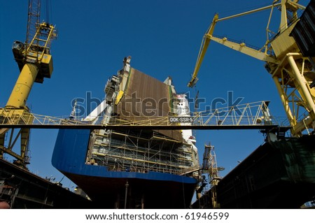 Big ferryboat in a dock during repairs. - stock photo
