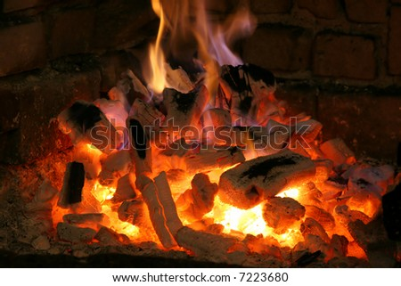 big fire from a big fireplace - stock photo