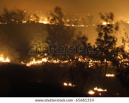 big fire in the steppe - stock photo