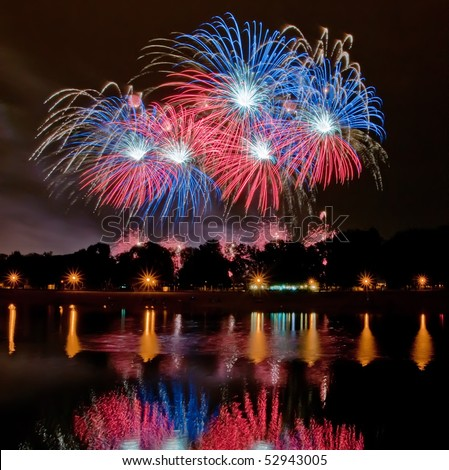 Big fireworks with reflection in the lake - stock photo