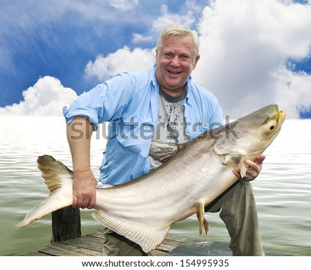 Big fish caught by angler - stock photo