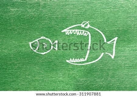 big fish eat little fish - stock photo