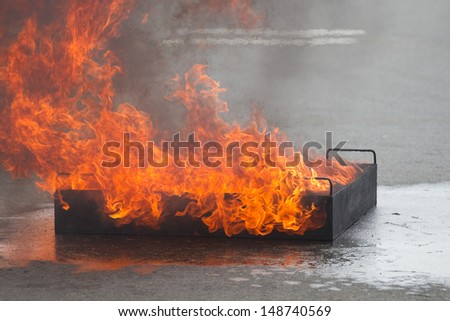 Big flame in container on fire safety training