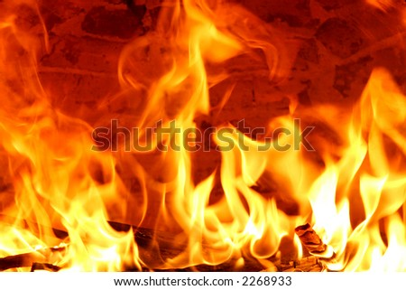big flames from a fire burning inside an oven - stock photo