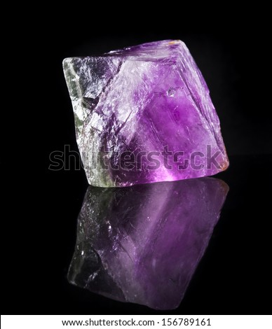 Big Fluorite Crystal Purple with reflection on black surface background