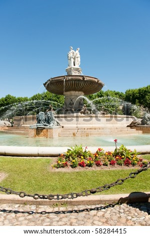 Big fountain in the middle of the French city Aix-en-Provence - stock photo