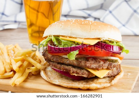 Big fresh  burger with french fries and beer - stock photo