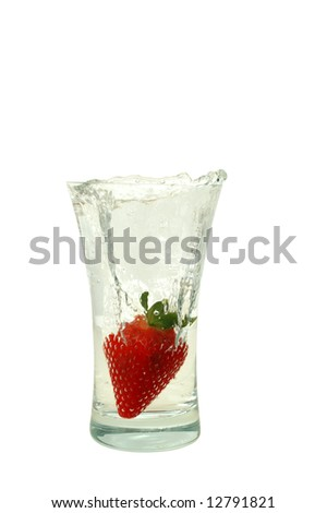 Big fresh strawberry in glass with bubble water isolated