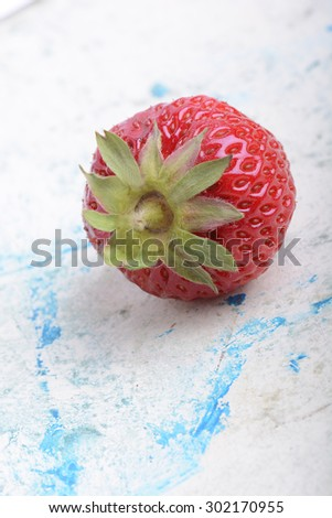 big fresh strawberry with green leave, close up - stock photo