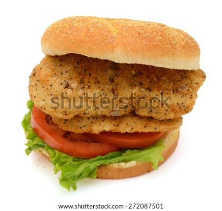 big fried fish sandwich isolated on white  - stock photo