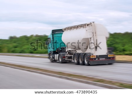 Big fuel gas tanker on the road motion blur