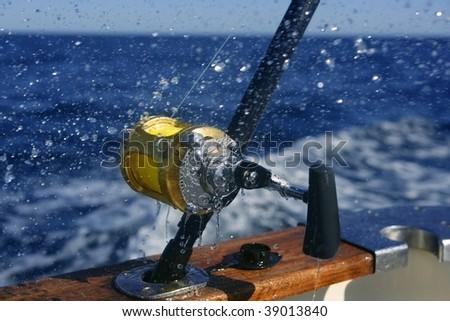 Big game boat fishing in deep sea on boat - stock photo