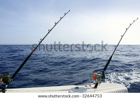 Big game boat saltwater fishing tourney with two rod and reel - stock photo