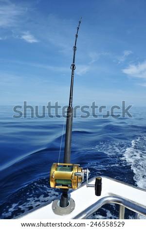 big game fishing reel and rod - stock photo