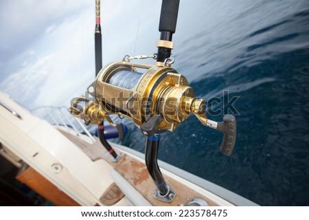 big game fishing reel in natural setting - stock photo