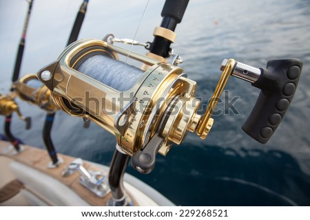 big game fishing reel in natural setting - stock photo