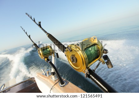 big game fishing reels and rods reels and rods - stock photo