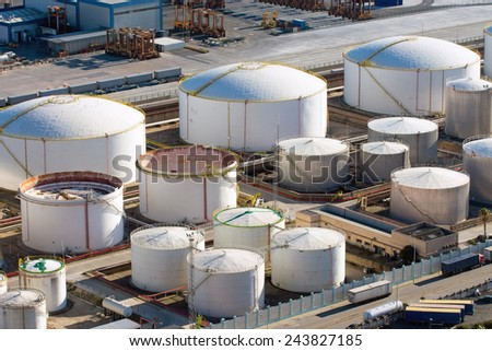 Big gas storage tanks seen in a harbour - stock photo