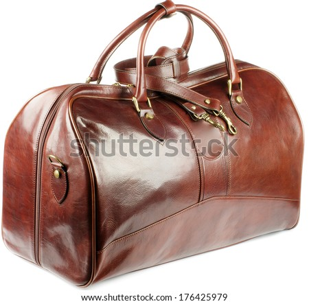 Big Ginger Leather Traveling Bag with Gold Details and Handles isolated on white background - stock photo
