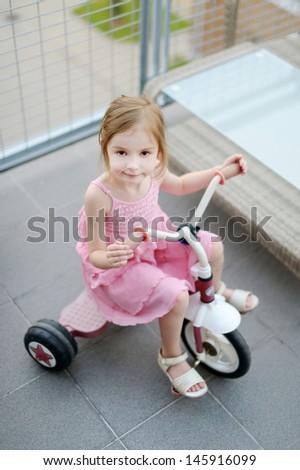 Big girl on a small bike - stock photo