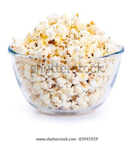Big glass bowl of freshly popped popcorn isolated on white background - stock photo