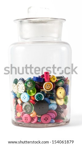 Big glass jar containing lots of colorful vintage buttons. Isolated against white background, with faint shadow on bottom right.