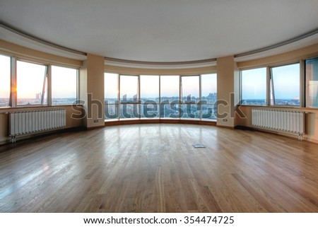 Big Glass Wall in Oval Room With Cityscape View - stock photo