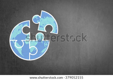 Big globe jigsaw puzzle piece connecting together conceptual design freehand doodle drawing sketch on school/ business office black chalkboard background: World Autism Awareness Day Month idea concept - stock photo