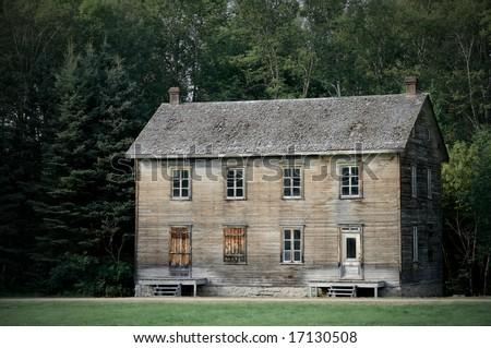 Big gloomy haunted house among dark trees. - stock photo