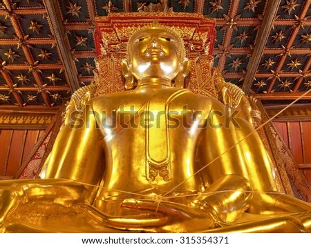 Big golden Buddha image in ancient Buddhist temple - Wat Phumin, Nan province, Thailand. In Thailand Buddha image are public domain, no artist name or any copy right appear on the image. - stock photo