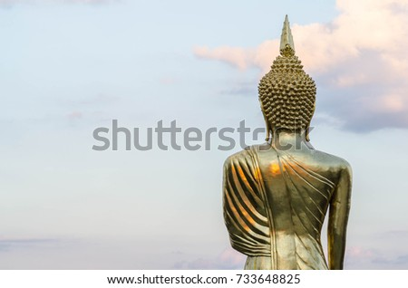 Big Golden Buddha statue against blue sky in north Thailand