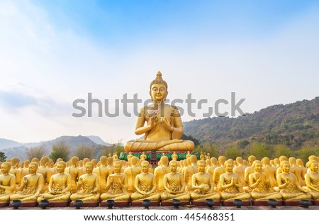 big golden buddha statue and many small golden buddha statues sitting in row in temple nakornnayok  thailand. - stock photo