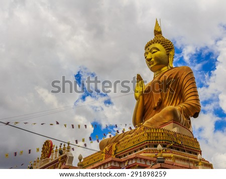 Big Golden Buddha statue in Thailand temple stockphoto - stock photo