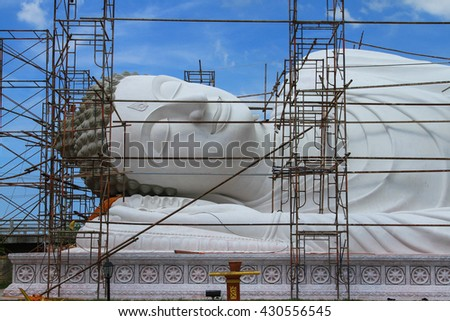Big Golden Buddha statue Repair:Select focus with shallow depth of