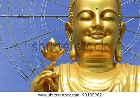 Big Golden Buddha with Lotus Flower  at Da Lat, Vietnam - stock photo