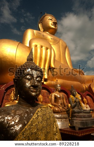 Big golden outdoor Buddha in Thai temple .