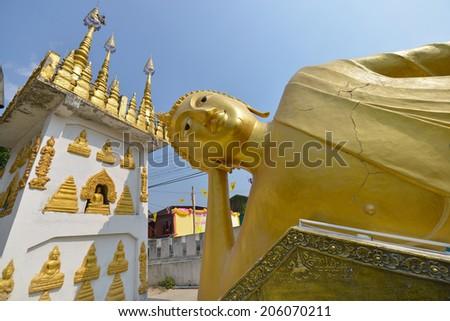 Big golden Reclining Buddha at Wat Luang in Phrae, Thailand. - stock photo