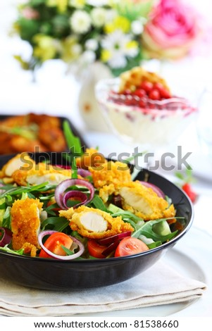 Big gourmet salad with mixed vegetable and  curry chicken stripes - stock photo