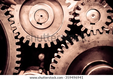 Big greasy gears in the old machine. - stock photo