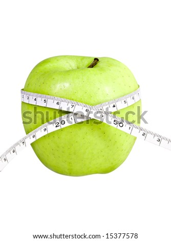 big green isolated apple with a measuring tape around it. - stock photo