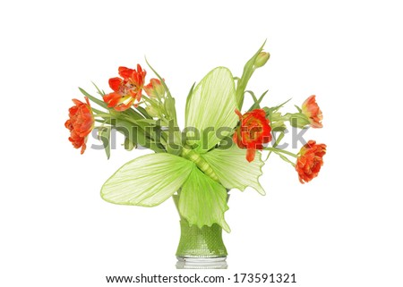 Big green paper butterfly and orange tulips in glass vase. - stock photo